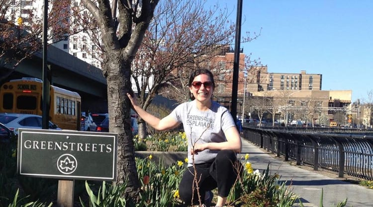 Jennifer Ratner posing next to a tree on the East River Esplanade